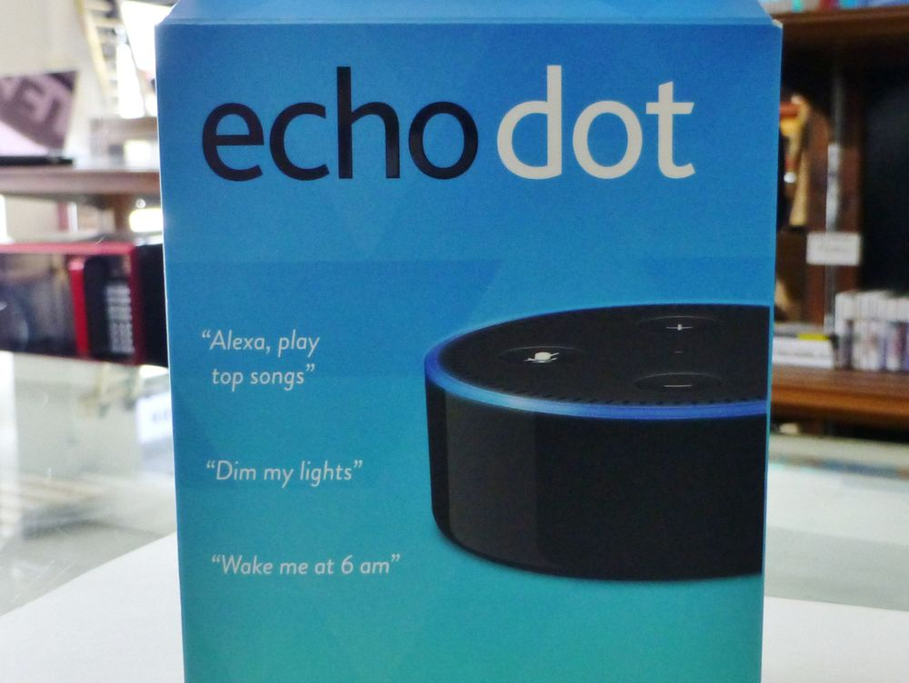 Amazon echo dot in a blue box