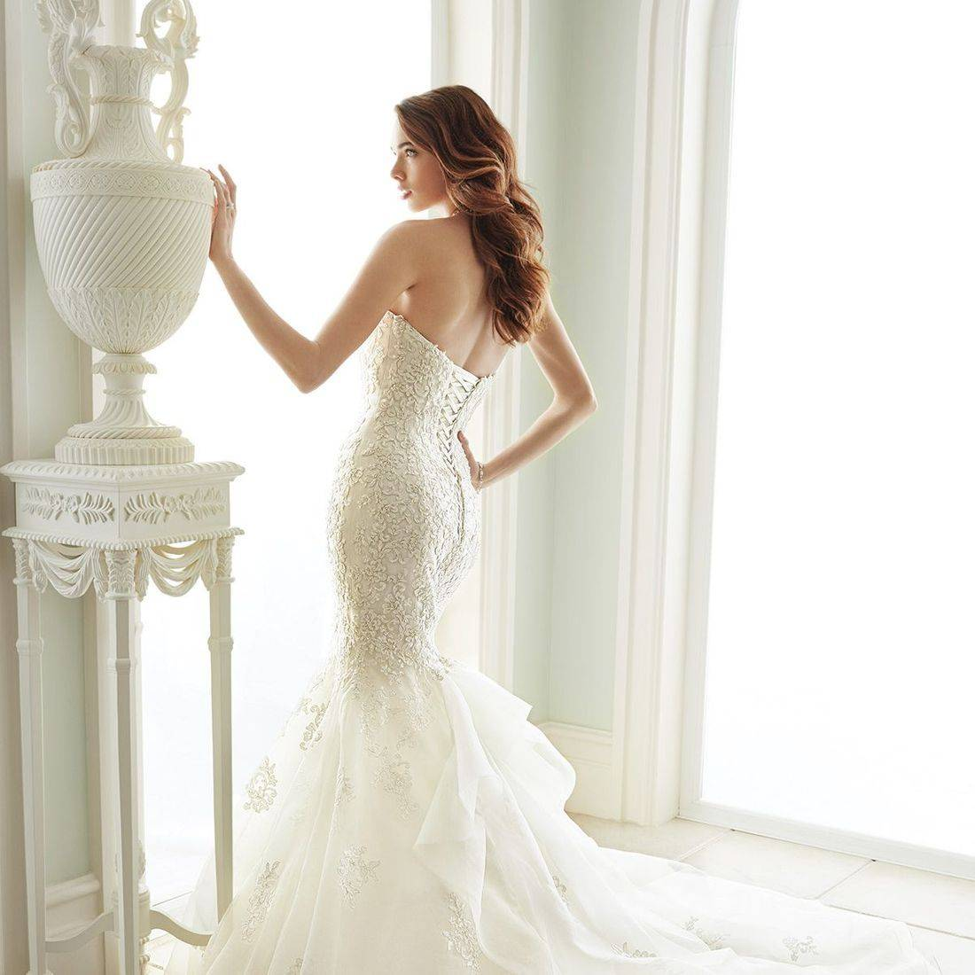 sophia tolli, sophia tolli wedding dress, organza wedding dress, fitted wedding dress, strapless wedding dress, elongated bodice wedding dress, sparkly wedding dress, ruffled wedding dress