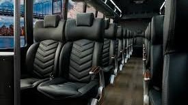 Inside front view of a 23 Passenger Executive Coach Bus. An Owner Operated 6 Passenger Limousine.