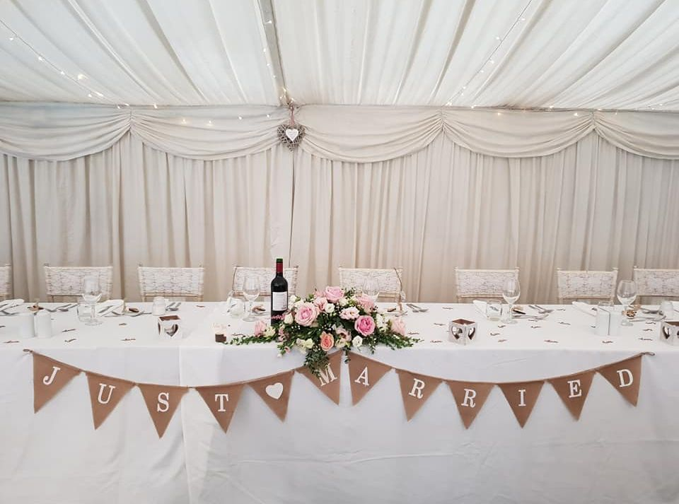 Simple, elegant white rustic wedding decor at The Old Vicarage in Hampshire