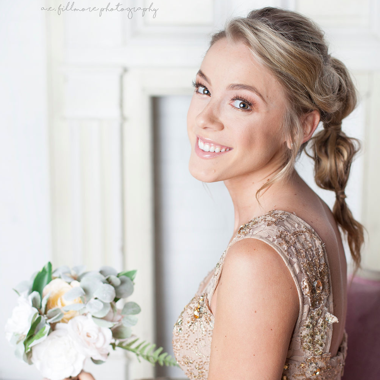 Bridesmaid with textured ponytail updo