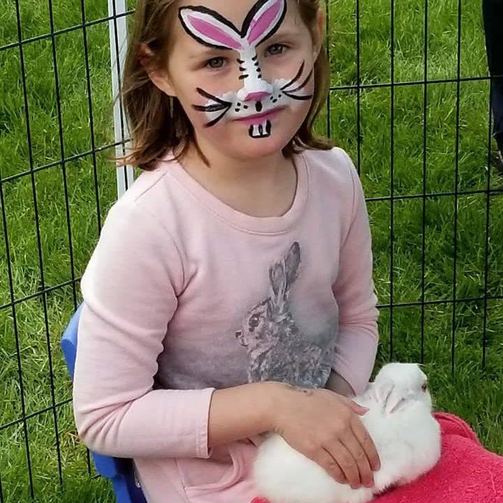 Girl holding bunny