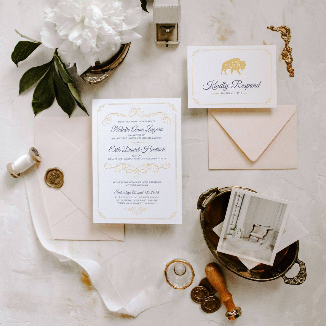 Vintage flat lay of elegant Buffalo themed wedding invitations with silk ribbon wax seal ring box and envelopes