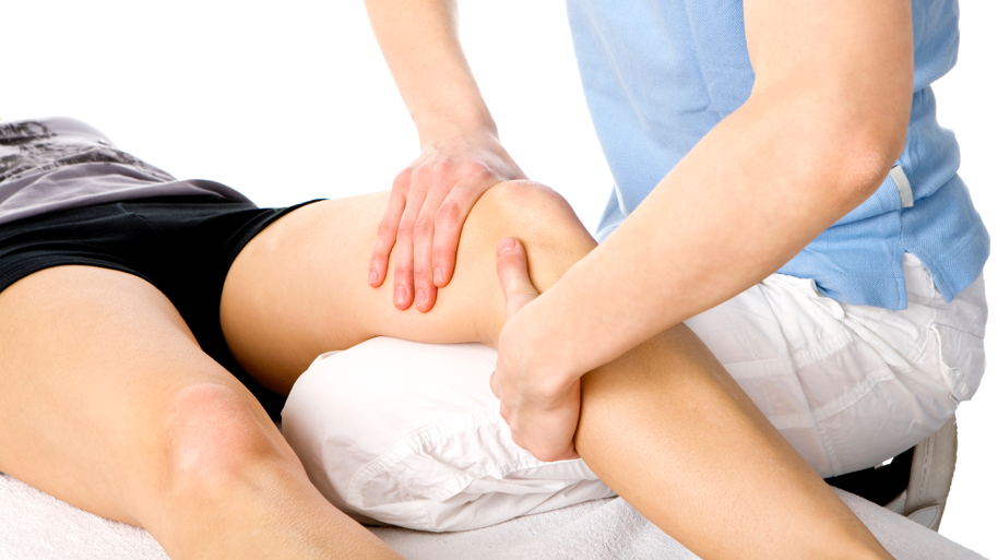 Physio Treating Knee Paid