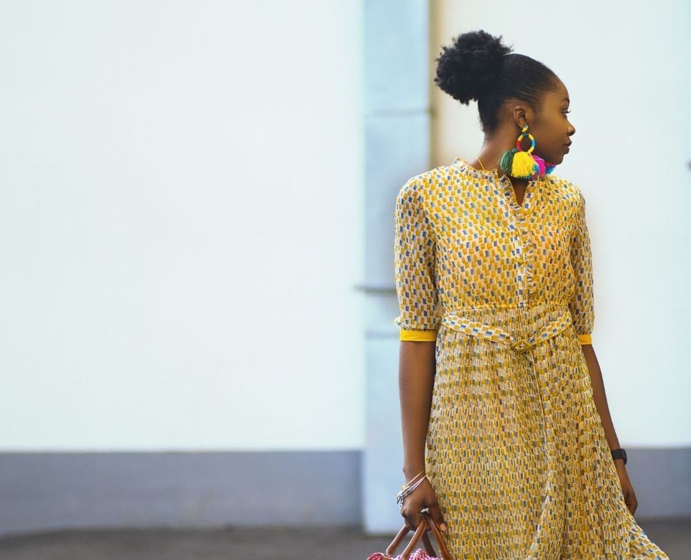 image of lady in yellow dress looking over her shoulder