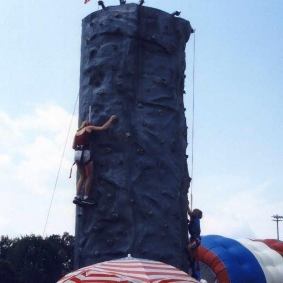 Kids climbing on a rock wall