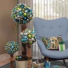 Sparkly ornaments and pillows add big impact to holiday decor. Enhance the look with these lovely Hunter Douglas Luminette sheers!
