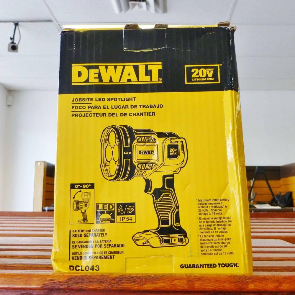 DeWalt jobsite spotlight in original box sitting on top of a shelf