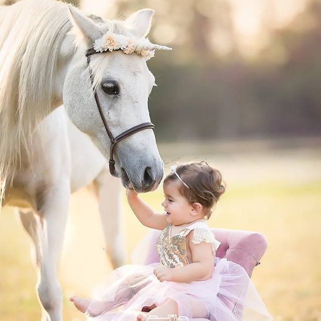 Unicorn with little girl