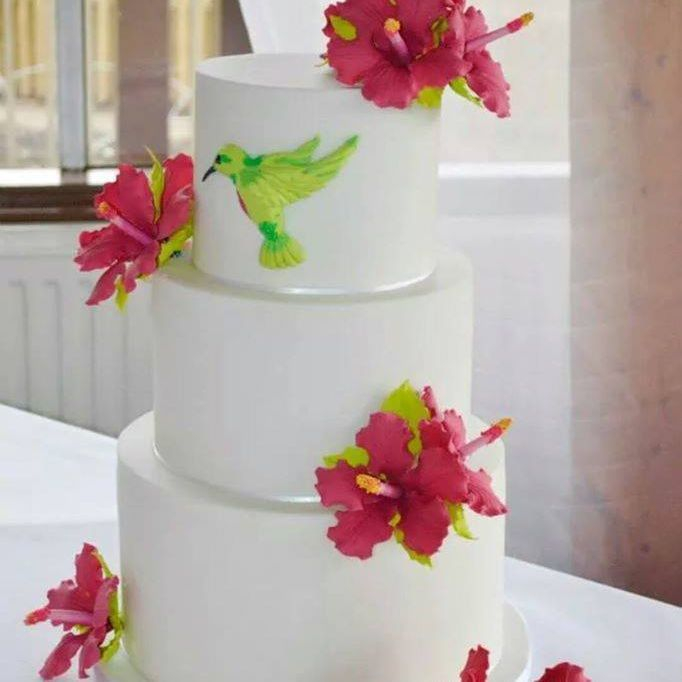 Tropical wedding cake humming bird hibiscus bright pink white lime green