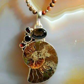 Ammonite with smokey quartz and garnet