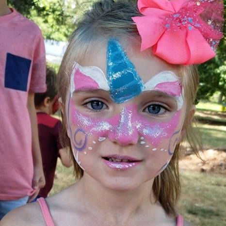Little girl with unicorn face paint