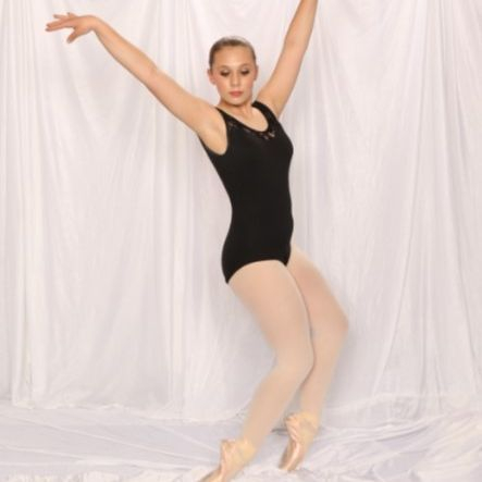 Before our ballet performance in downtown Spokane,  Gillian stretches in pointe.