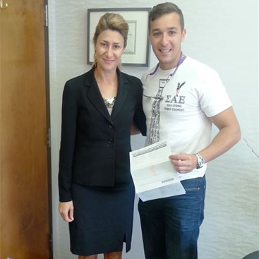 Emel Ersan with a client after winning his case