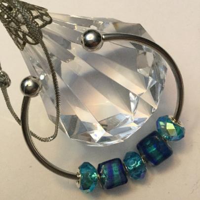 Iridescent Aqua / Blue Lampwork Glass Beads on Silver Toned Bangle Bracelet