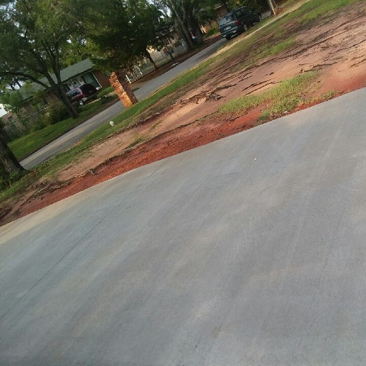 After removing red clay from driveway