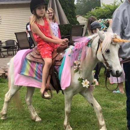 Boy riding a pony dressed up for Kentucky derby