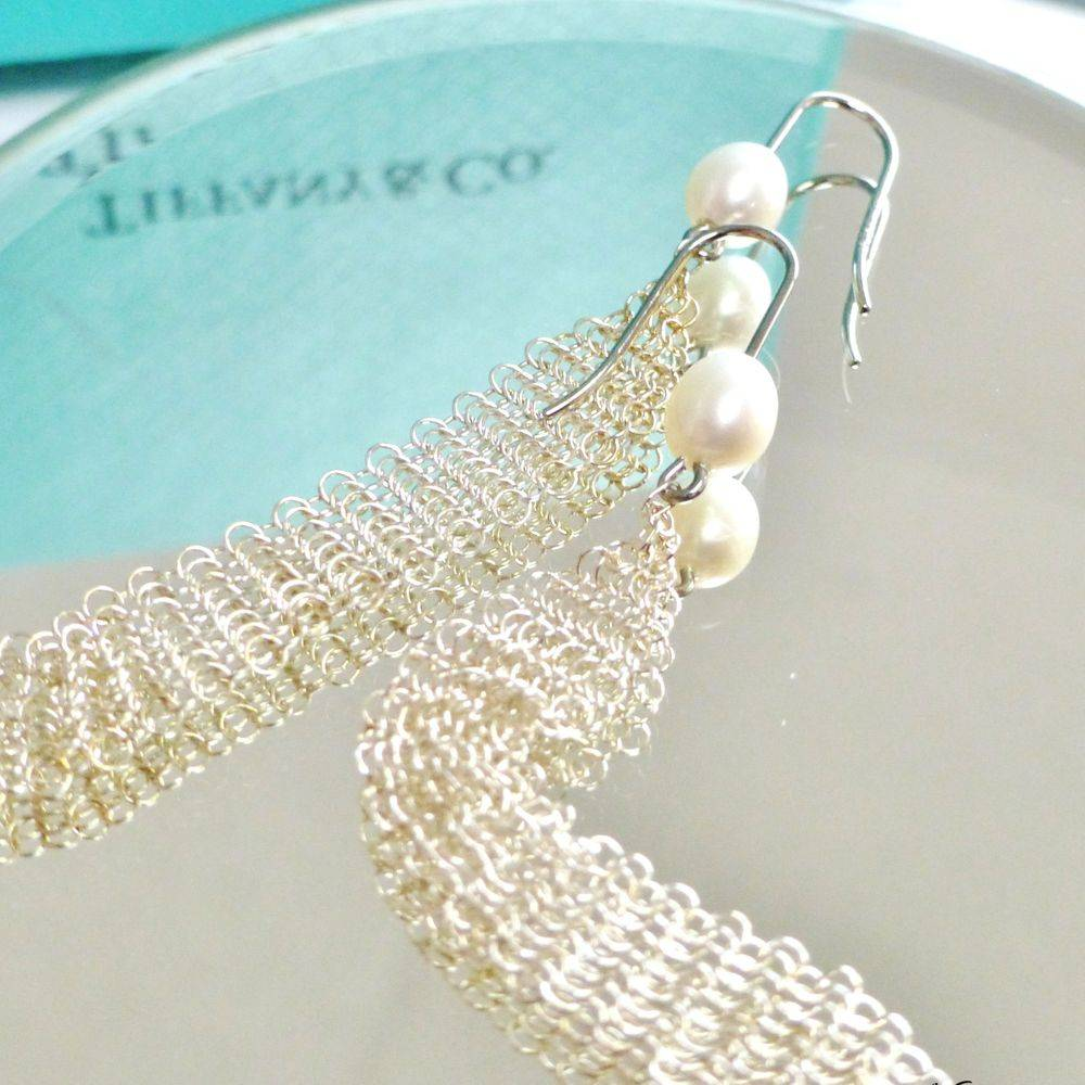 closeup picture of a pair of Tiffany & Co. sterling silver pearl mesh tassel earrings designed by Elsa Peretti
