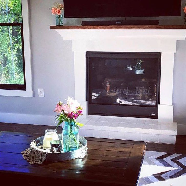 Fireplace, living room, large windows, black frame windows