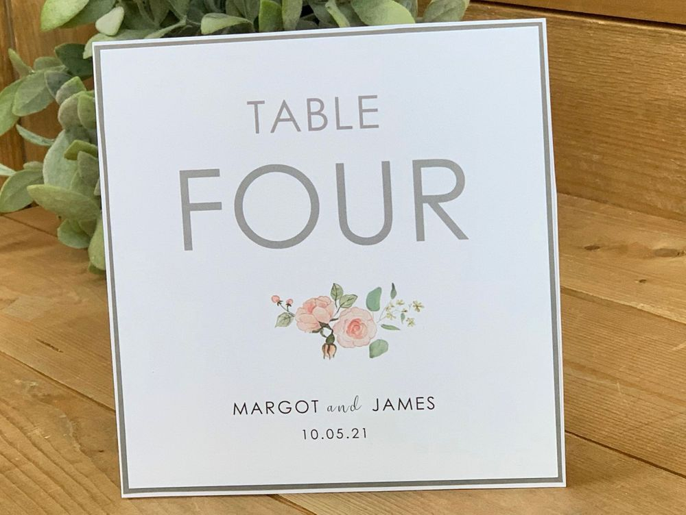 White and Grey table number with blush pink roses