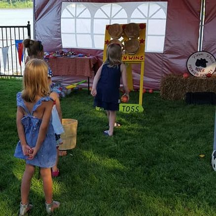 Girls playing apple toss game