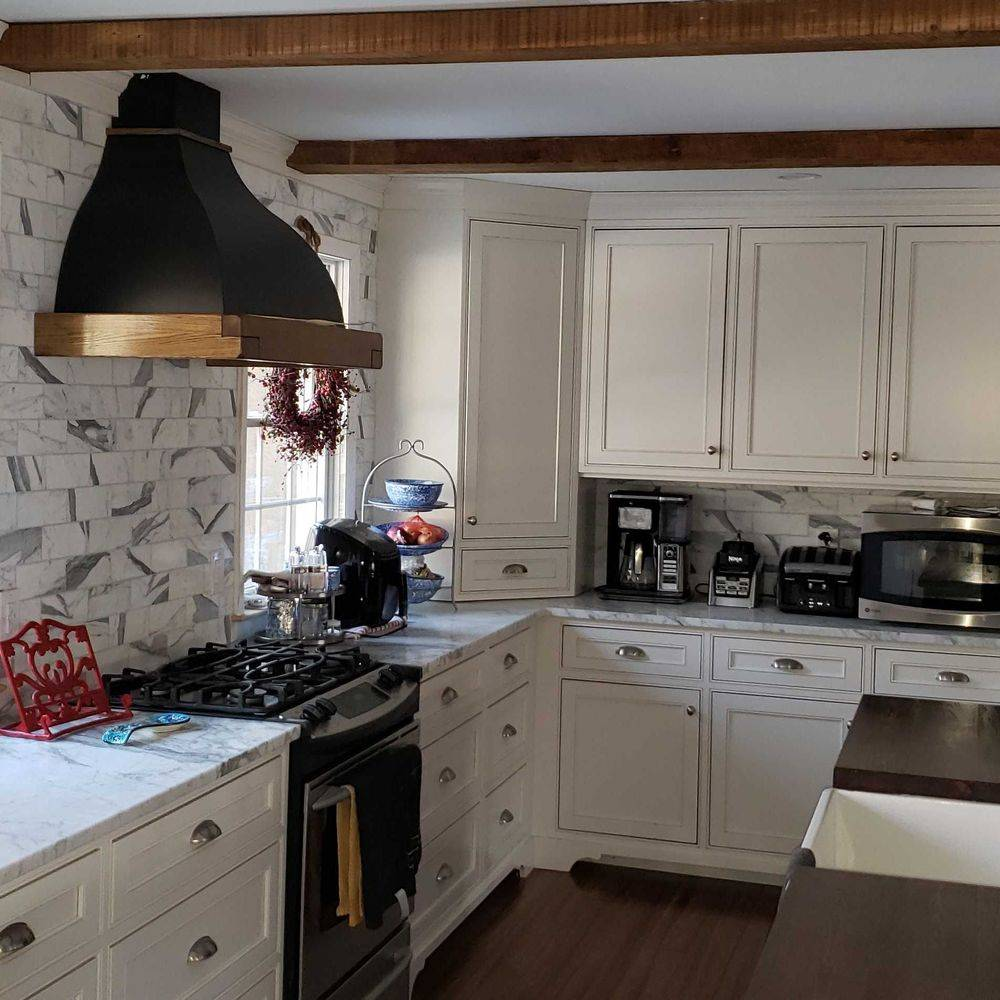 Remodeled Kitchen Featuring Open Wood Beams and Beautiful Tiling