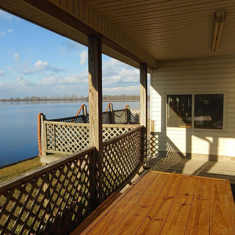 deck, store, picnic tables, river view, relax
