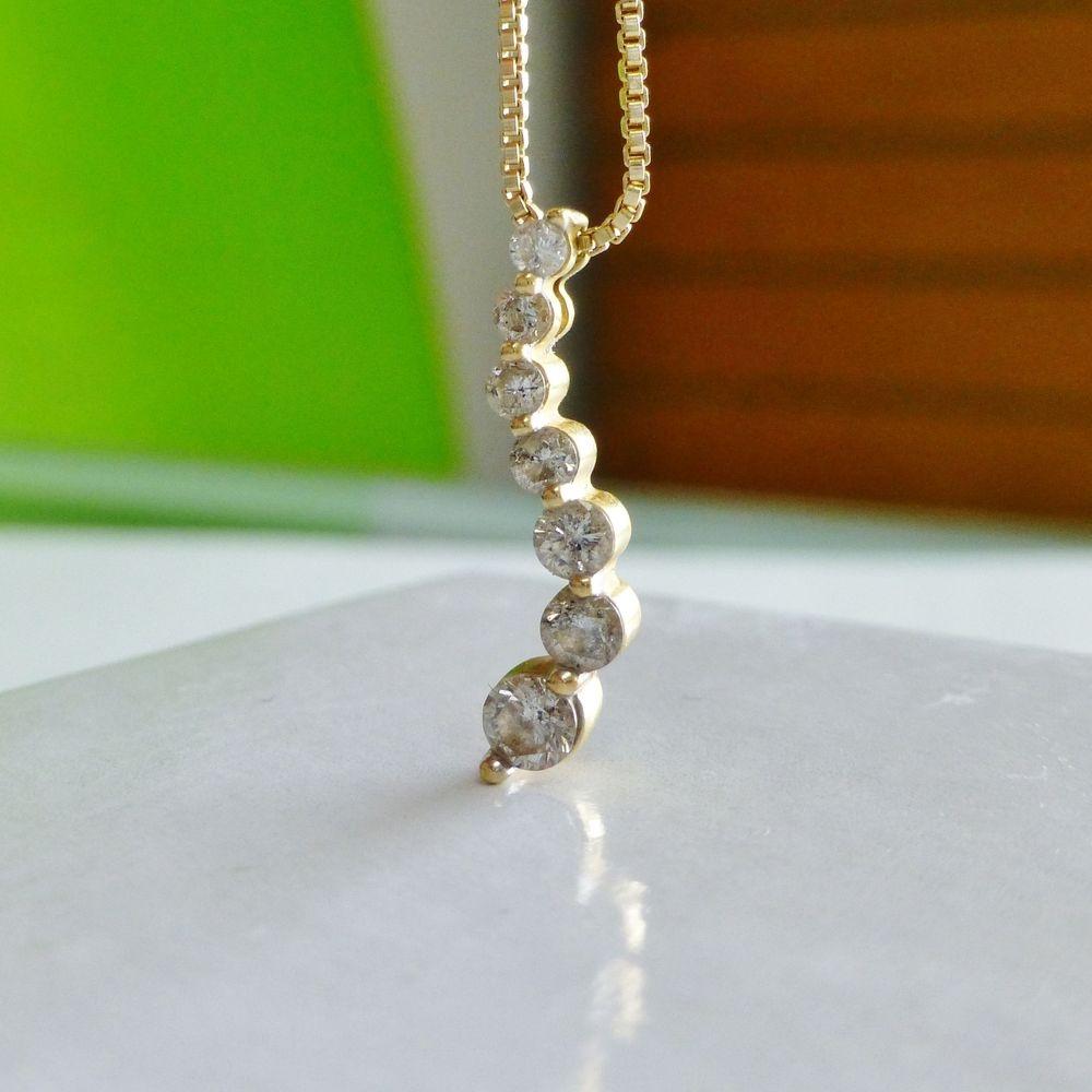Round Cut Diamond 7 Stone Journey Pendant in Yellow Gold