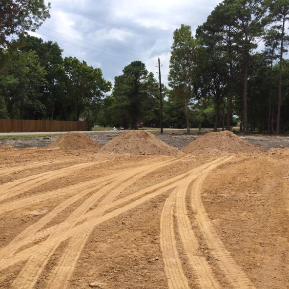 select fill, fill dirt, pads, dirt pad, dump truck hauling