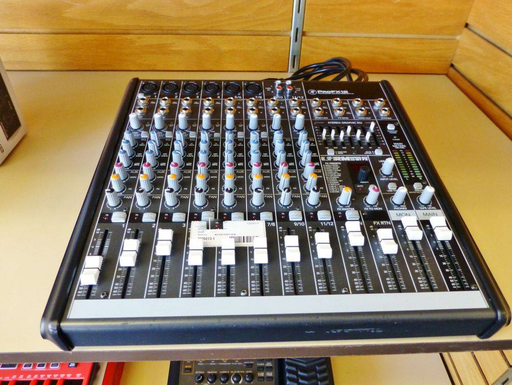 close up picture of a Mackie ProFX12 mixer on a shelf