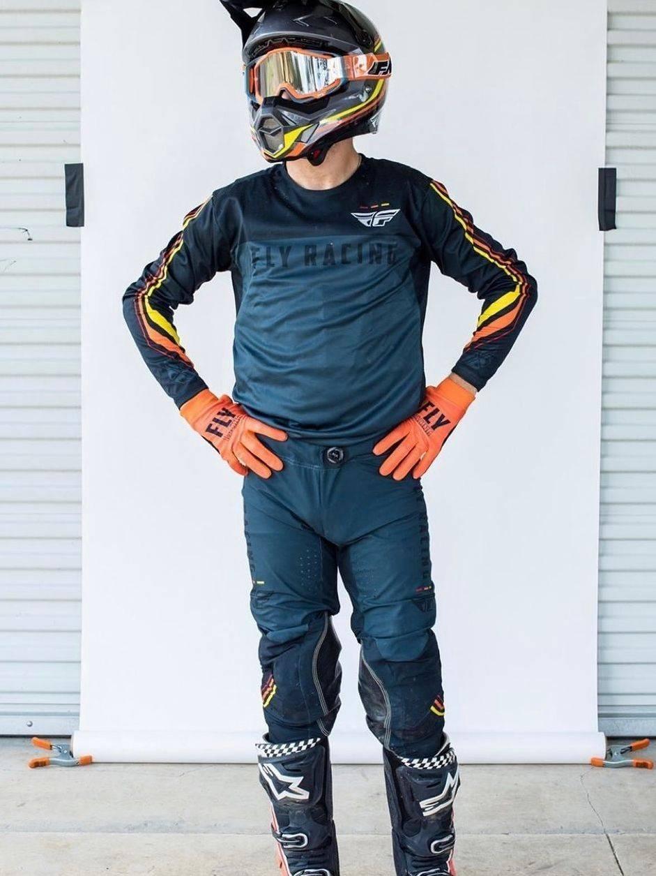 Racer in black FLY gear