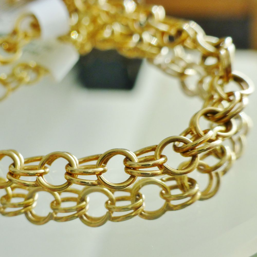 yellow gold charm bracelet with circle links