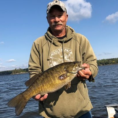 Fishing, Trophy Fishing, Manitoba fishing, family vacations, cabin rentals, boat rentals, canoe route, Nopiming Provincial Park, walleye, swimming