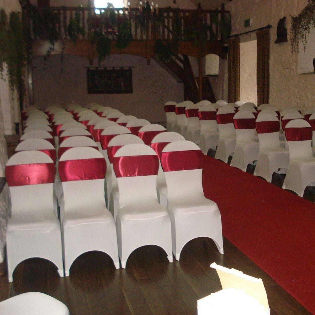 White Chair Covers with Garnet Satin Sash