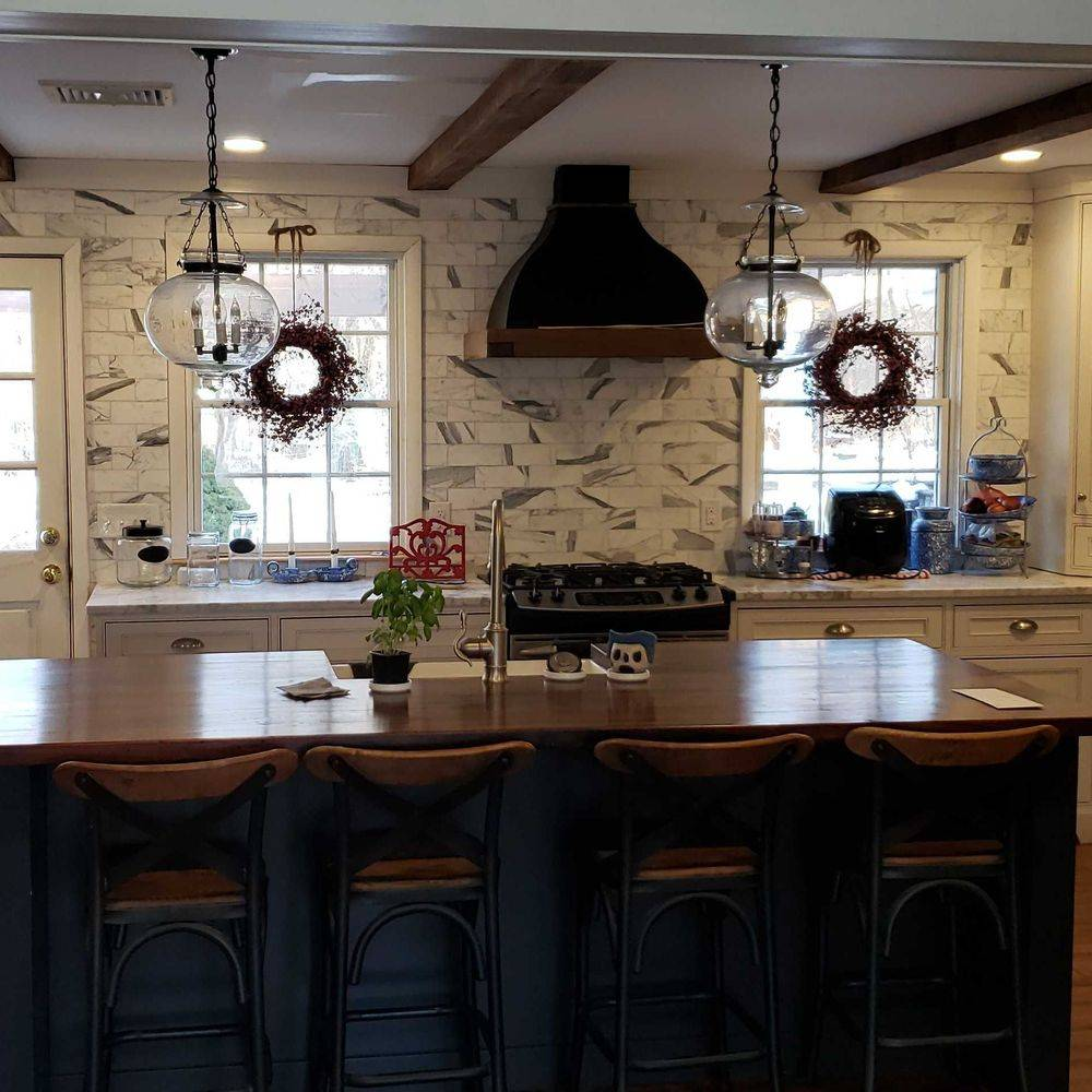 Newly Renovated Kitchen Featuring Custom-Made Wood Kitchen Island