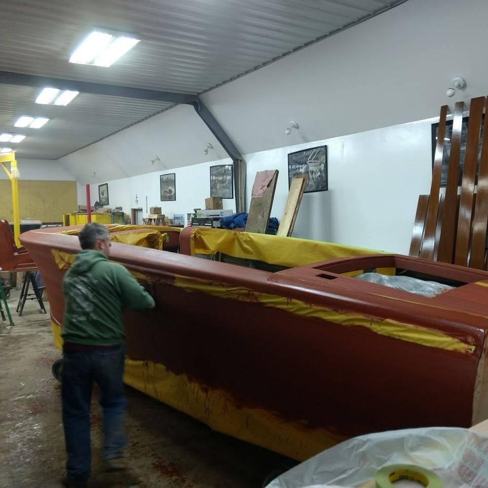 new shepherd boat applying stain