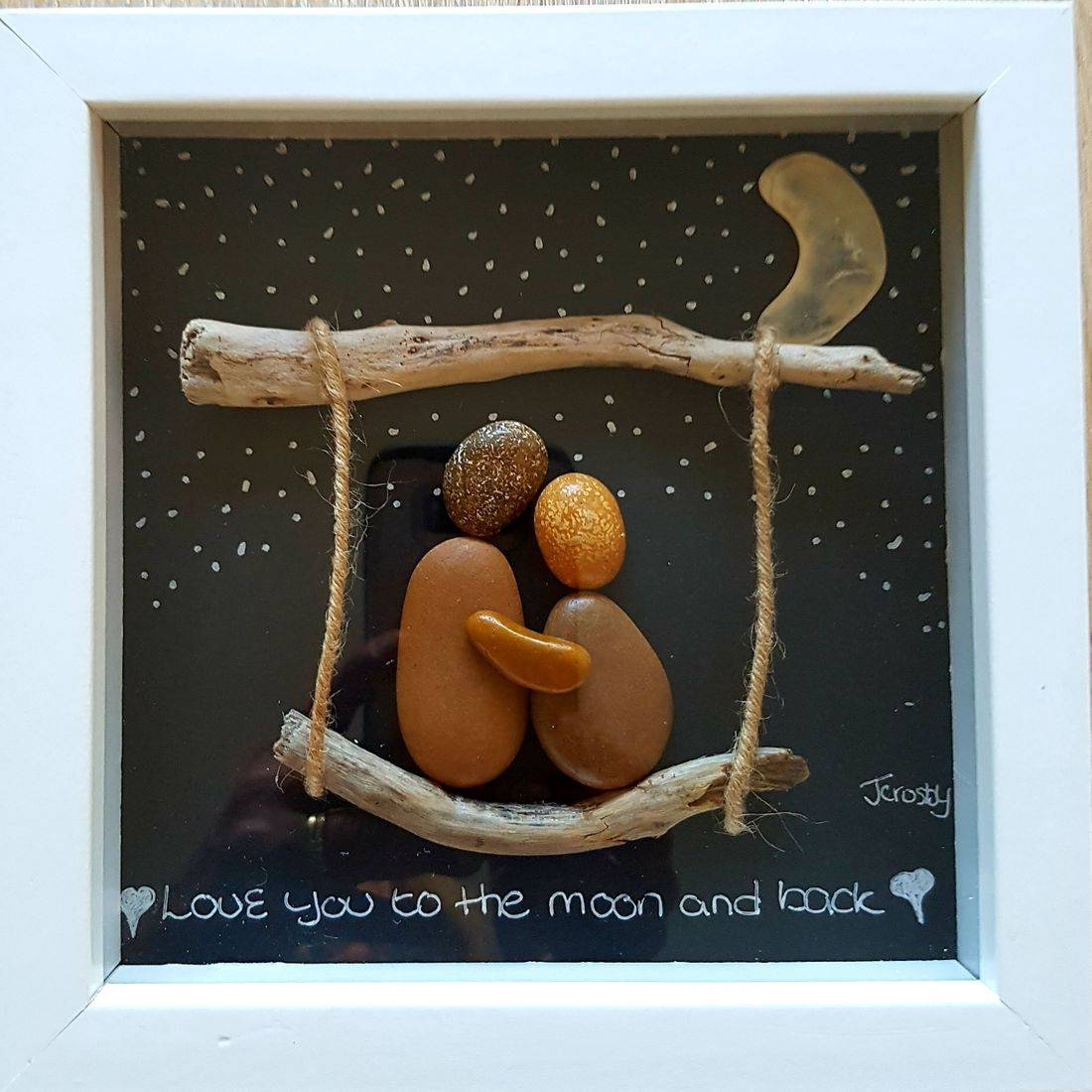 couple on swing pebble art