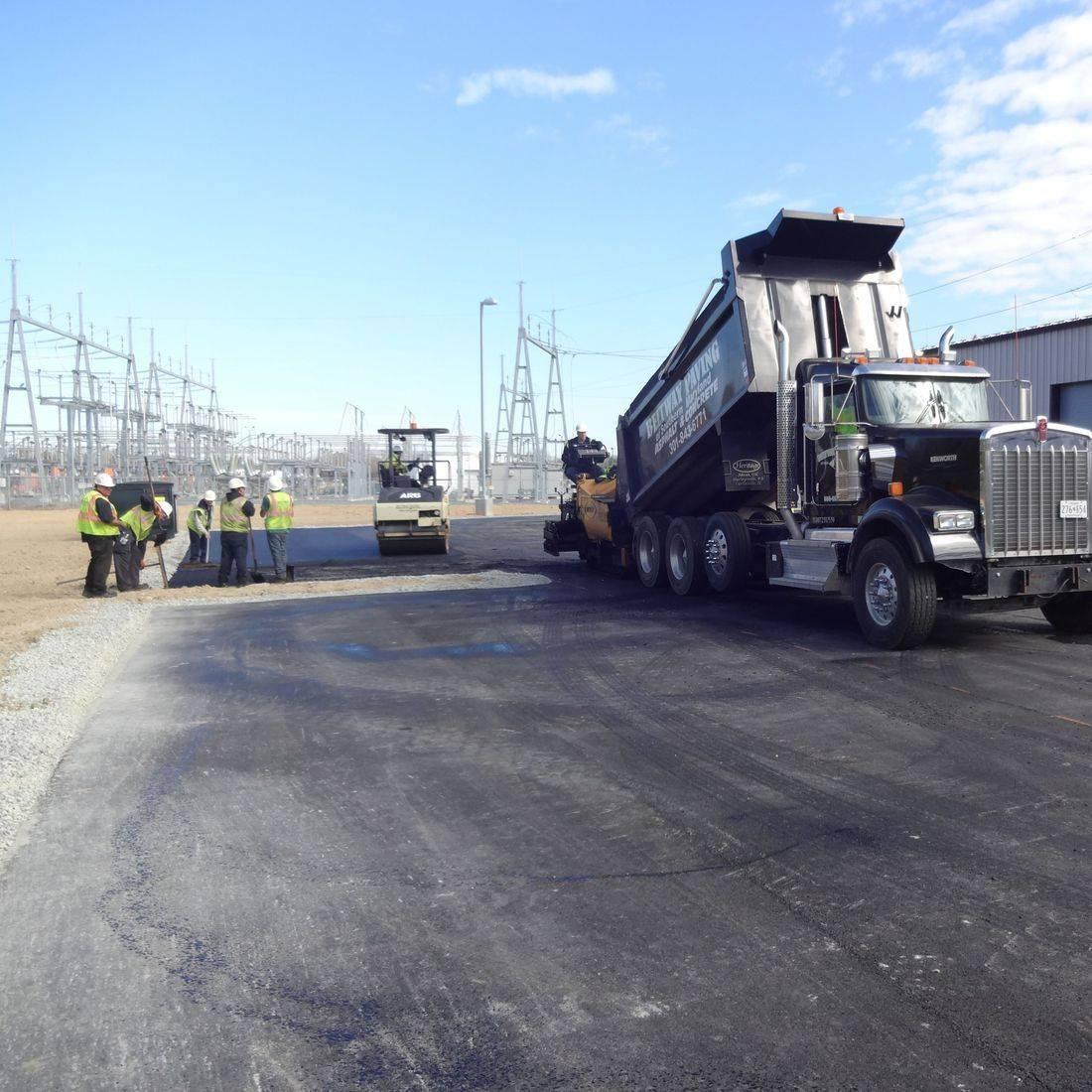 installing asphalt roadway