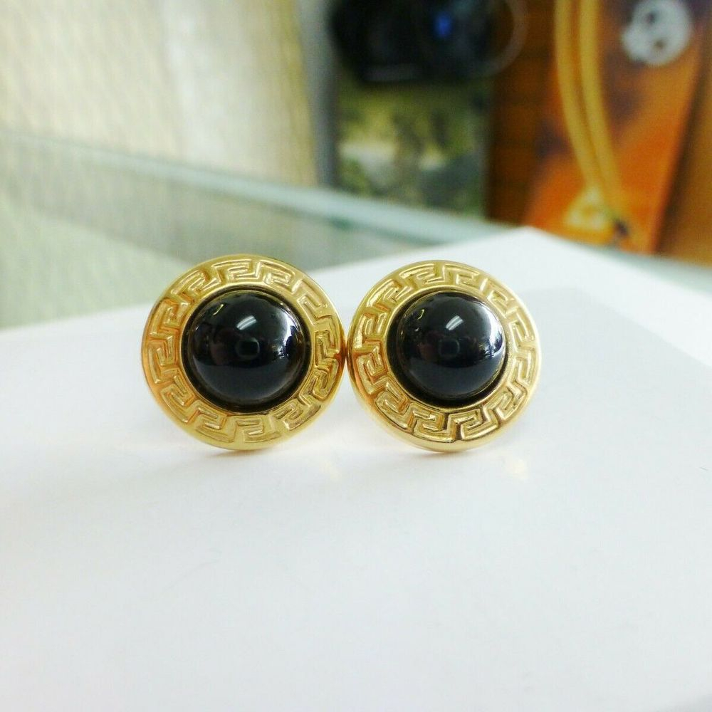 closeup picture of a pair of 14K greek key link framed button black onyx earrings