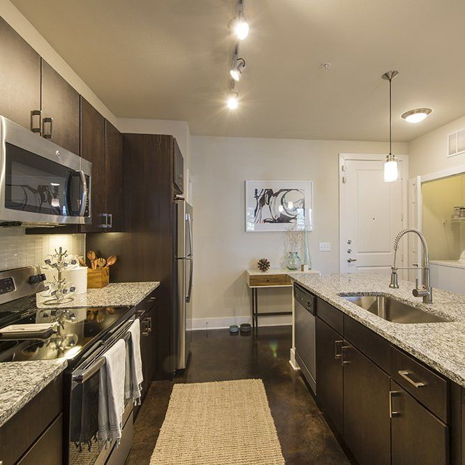 apartment kitchen island, granite counters, track light, wood floor,