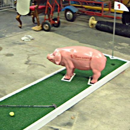 Putt putt course with pig