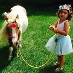 little girl and mini horse