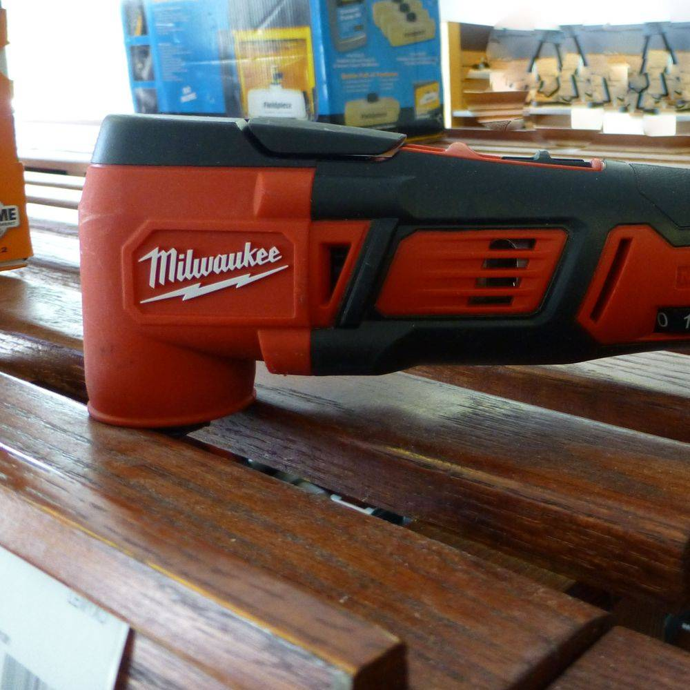 closeup picture of red and black Milwaukee Oscillating Tool
