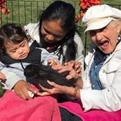 Child and old woman holding a bunny