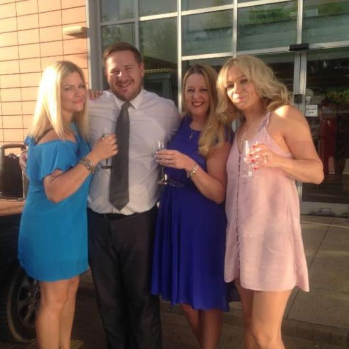 3 ladies and man outside with drinks