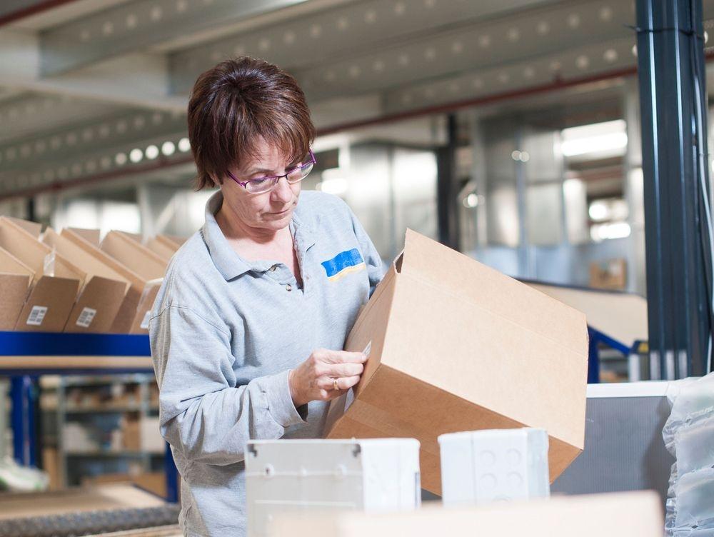 Warehouse clerk receiving packages