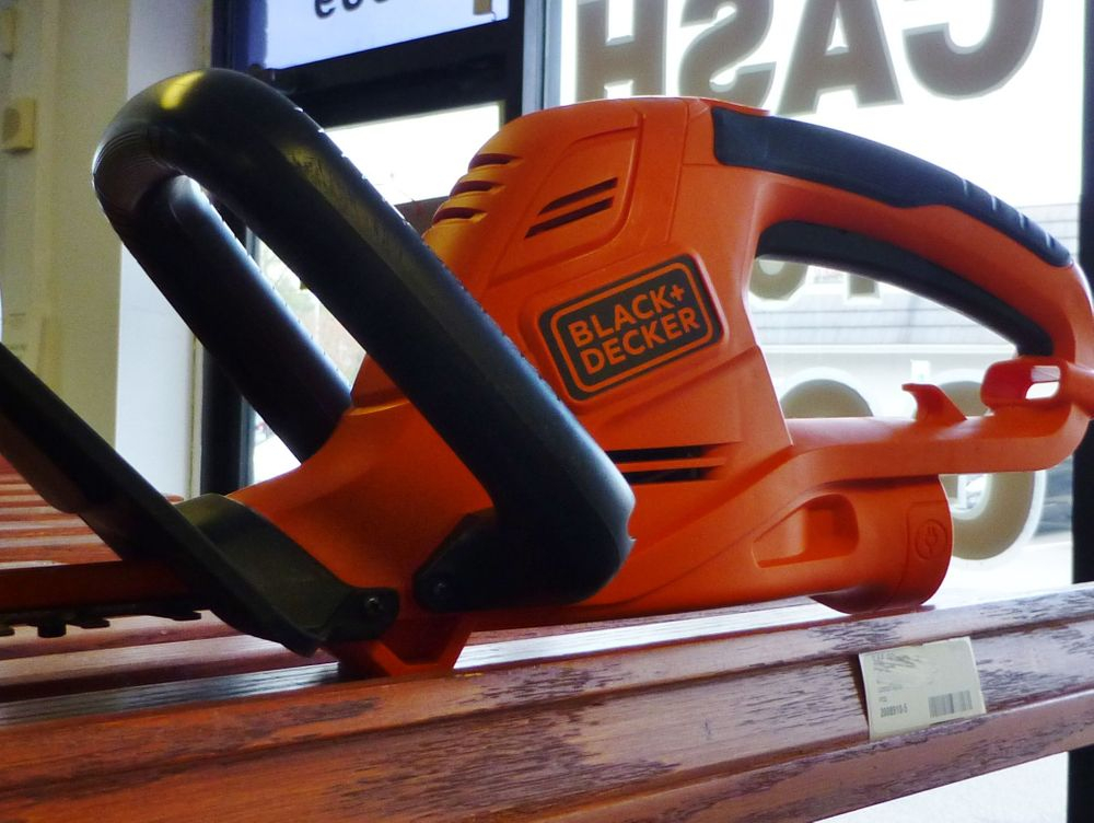 close up picture of a black and orange black & decker electric hedge trimmers