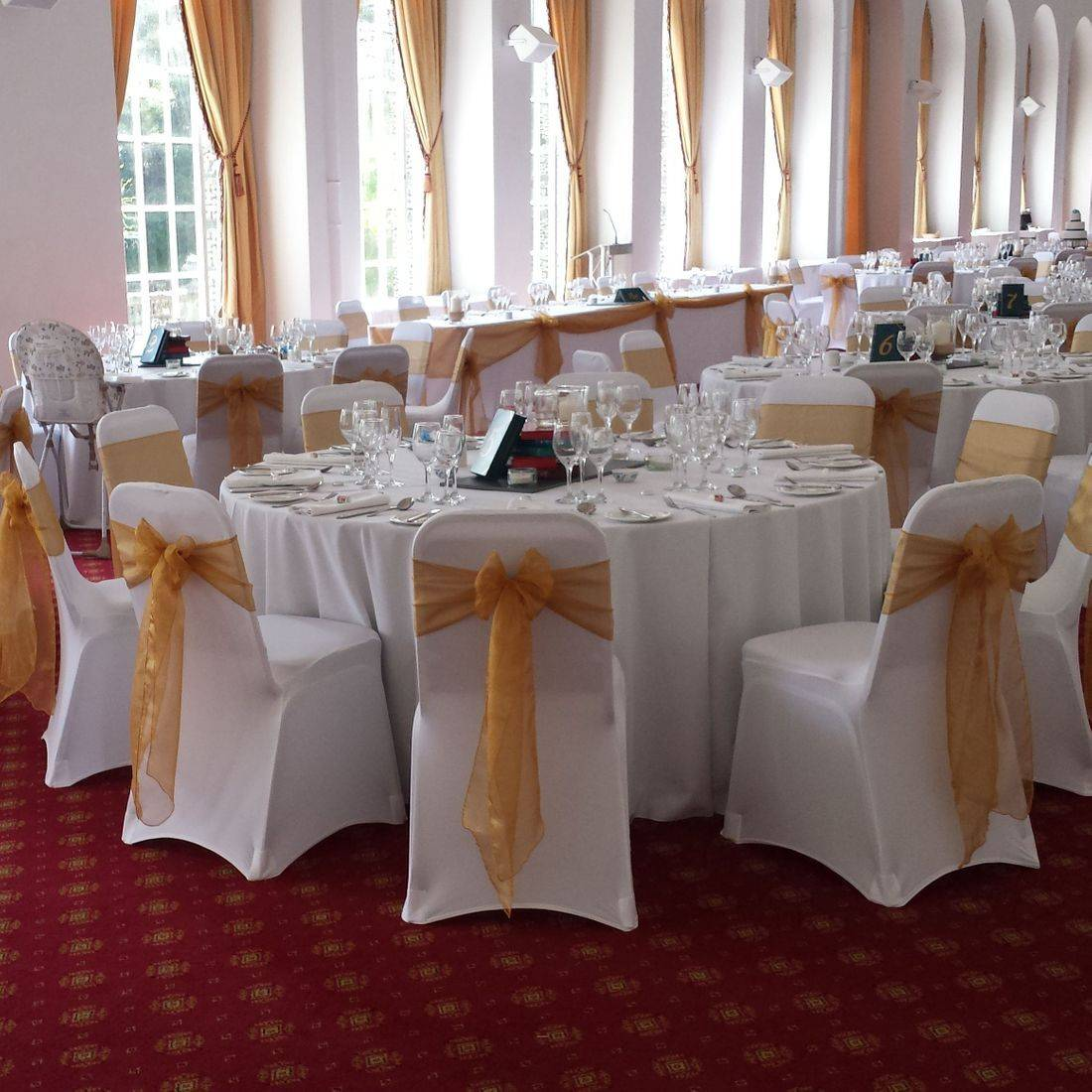 White Chair Covers with Gold Organza  Sash