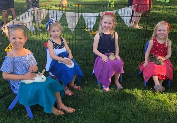 Little girls holding bunnies
