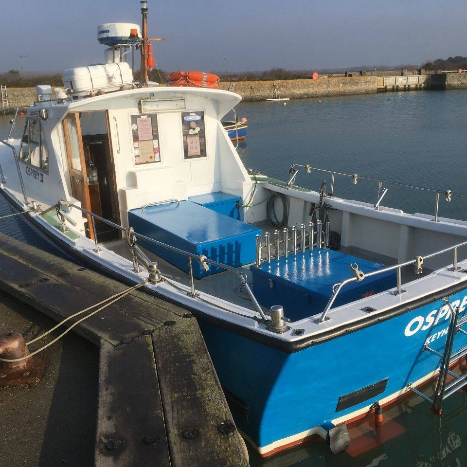 Fishing boat Osprey II alongside the quay at Keyhaven